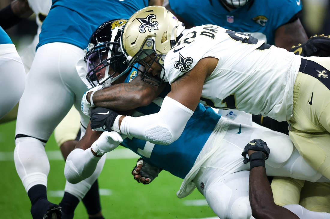 Aug 23, 2021; New Orleans, Louisiana, USA;  New Orleans Saints defensive end Marcus Davenport (92) tackles Jacksonville Jaguars running back Nathan Cottrell (31) during the first half at Caesars Superdome. Mandatory Credit: Stephen Lew-USA TODAY Sports