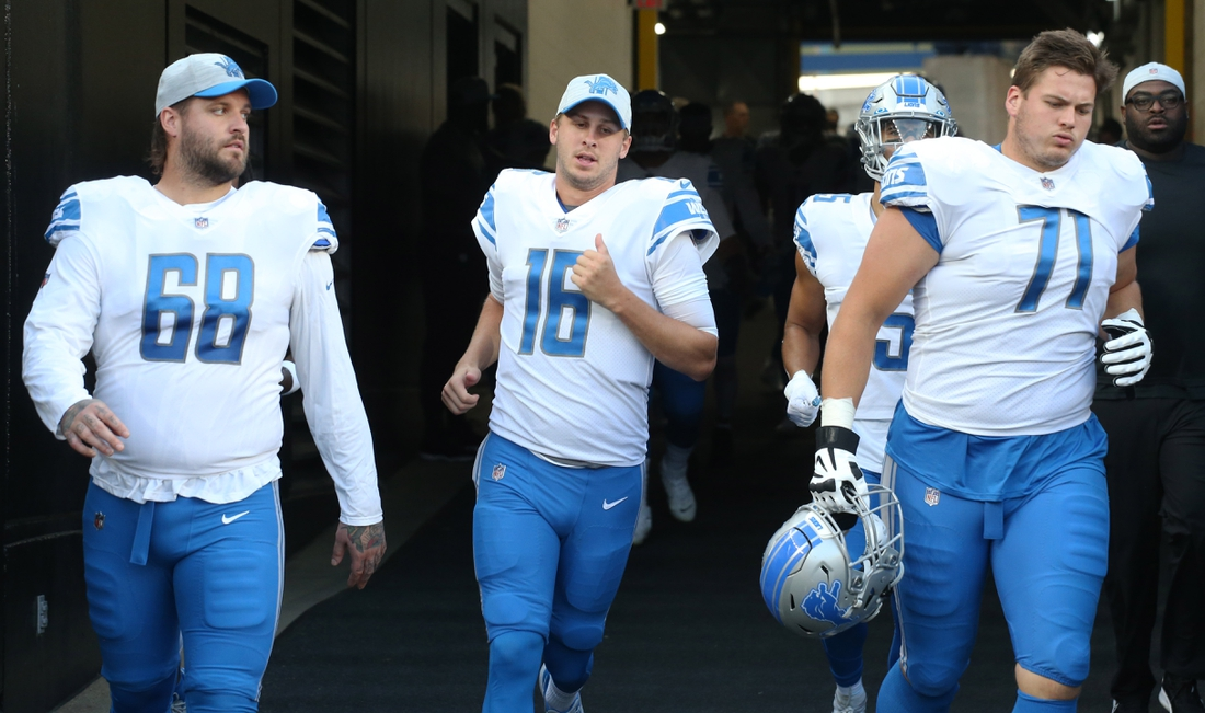 Aug 21, 2021; Pittsburgh, Pennsylvania, USA;  Detroit Lions offensive tackle Taylor Decker (68) and quarterback Jared Goff (16) and offensive guard Logan Stenberg (71) take the field to play the Pittsburgh Steelers at Heinz Field. Mandatory Credit: Charles LeClaire-USA TODAY Sports