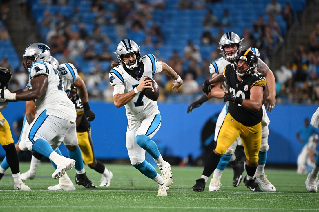 Aug 27, 2021; Charlotte, North Carolina, USA;  Carolina Panthers quarterback Will Grier (7) runs for a touchdown as Pittsburgh Steelers defensive end Isaiahh Loudermilk (92) defends in the fourth quarter at Bank of America Stadium. Mandatory Credit: Bob Donnan-USA TODAY Sports