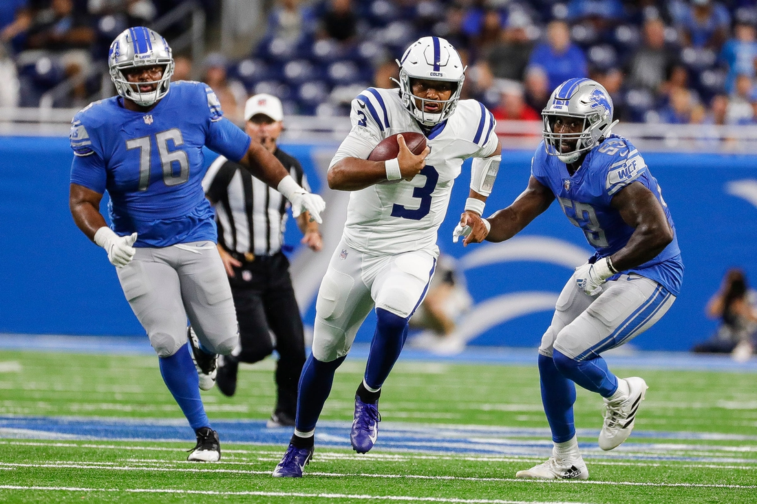 Indianapolis Colts quarterback Brett Hundley (3) runs against Detroit Lions defensive end Bruce Hector (76) and  linebacker Charles Harris (53) during the second half of a preseason game at Ford Field in Detroit on Friday, Aug. 27, 2021.