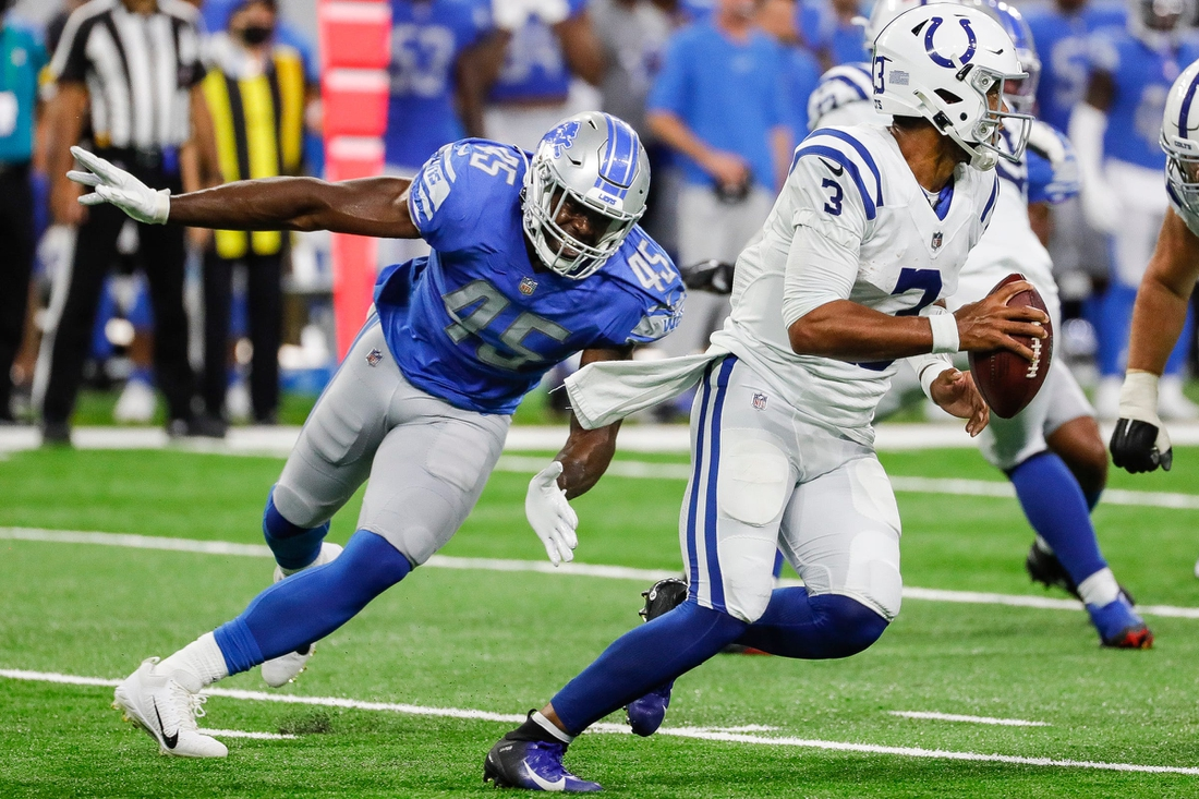 Detroit Lions linebacker Rashod Berry (45) tries to stop Indianapolis Colts quarterback Brett Hundley (3) during the second half of a preseason game at Ford Field in Detroit on Friday, Aug. 27, 2021.