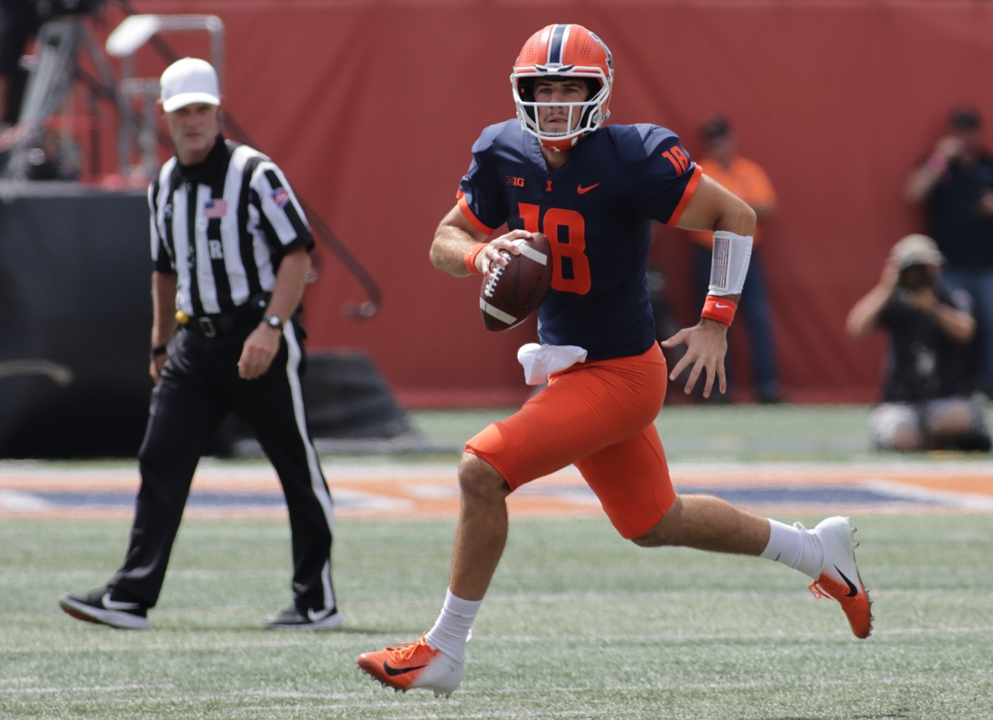 Aug 28, 2021; Champaign, Illinois, USA; Illinois quarterback Brandon Peters (18) runs with the ball in the first quarter during Saturday   s game with Nebraska at Memorial Stadium. Mandatory Credit: Ron Johnson-USA TODAY Sports