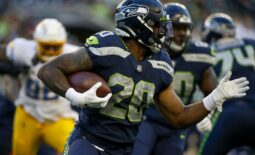 Aug 28, 2021; Seattle, Washington, USA; Seattle Seahawks running back Rashaad Penny (20) rushes against the Los Angeles Chargers during the first quarter at Lumen Field. Mandatory Credit: Joe Nicholson-USA TODAY Sports