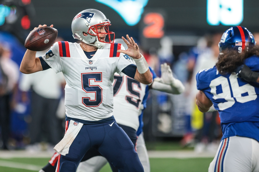 Aug 29, 2021; East Rutherford, New Jersey, USA; New England Patriots quarterback Brian Hoyer (5) throws the ball against the New York Giants during the second half at MetLife Stadium. Mandatory Credit: Vincent Carchietta-USA TODAY Sports