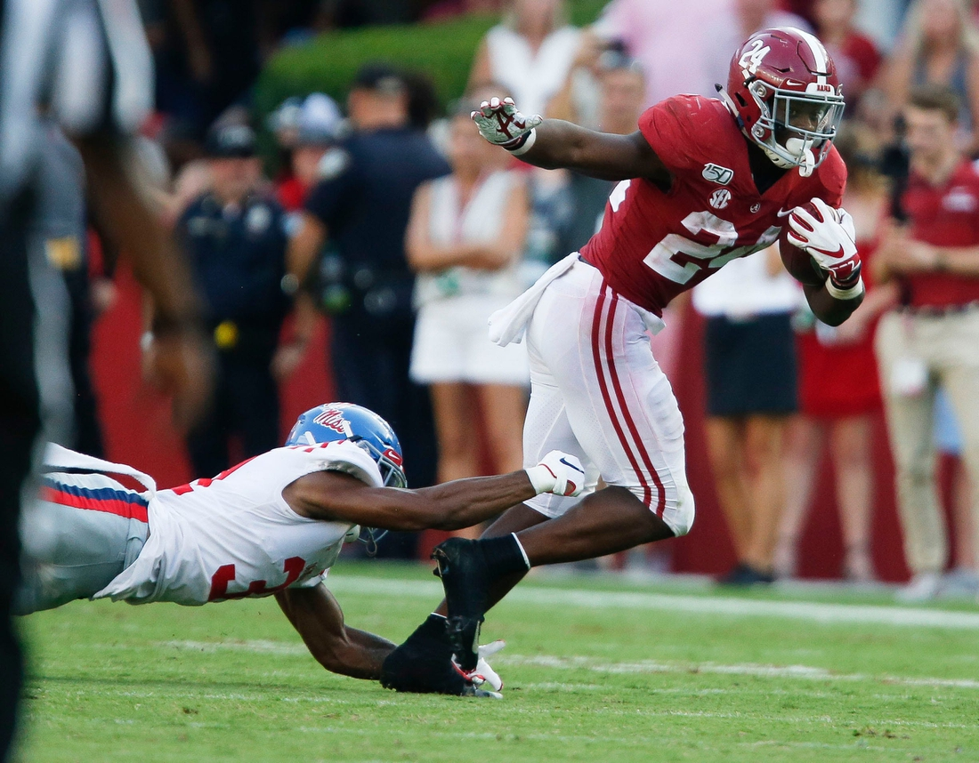 Ole Miss defensive back Jaylon Jones (31) dives to try to make a tackle on Alabama running back Brian Robinson Jr. (24) during the second half of Alabama's 59-31 victory over Ole Miss Saturday, Sept. 28, 2019. [Staff Photo/Gary Cosby Jr.]  Alabama Vs Ole Miss