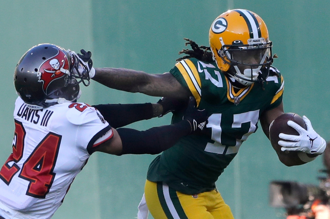Green Bay Packers wide receiver Davante Adams (17) against Tampa Bay Buccaneers cornerback Carlton Davis (24) during the NFC Championship game on Sunday, January 24, 2021, at Lambeau Field in Green Bay, Wis.  Mjs Apc Packers Vs Bucs Nfc Champ 0653 012421 Wag