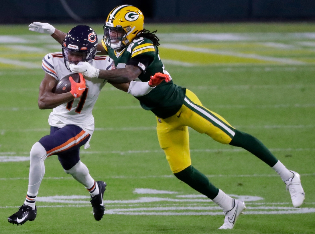 Green Bay Packers cornerback Kevin King (20) dives for Chicago Bears wide receiver Darnell Mooney (11)  on Sunday, November 29, 2020, at Lambeau Field in Green Bay, Wis.  King