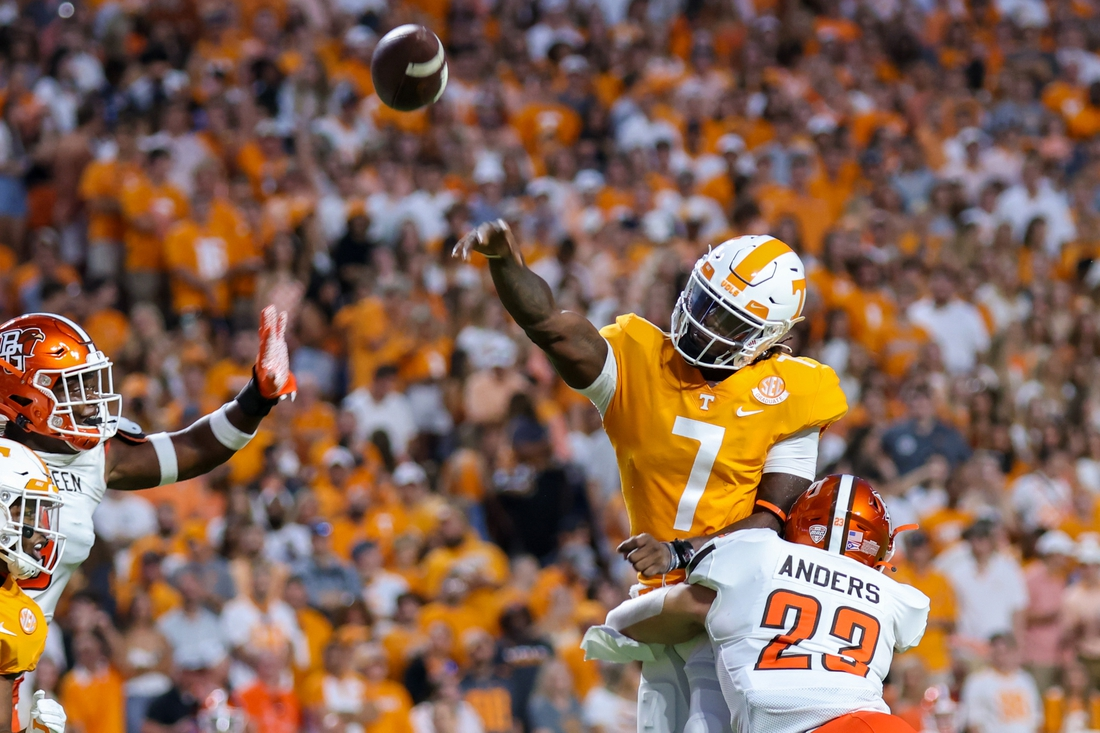 Sep 2, 2021; Knoxville, Tennessee, USA; Tennessee Volunteers quarterback Joe Milton III (7) throws the ball against Bowling Green Falcons linebacker Darren Anders (23) during the first quarter at Neyland Stadium. Mandatory Credit: Randy Sartin-USA TODAY Sports