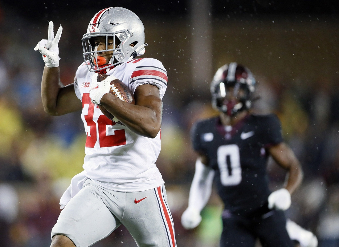 Ohio State Buckeyes running back TreVeyon Henderson (32) scores a touchdown after a catch against Minnesota Golden Gophers during the fourth quarter of their game in Huntington Bank Stadium at University of Minnesota in Minneapolis, MN on September 2, 2021.  Ceb Osu21min Kwr 47