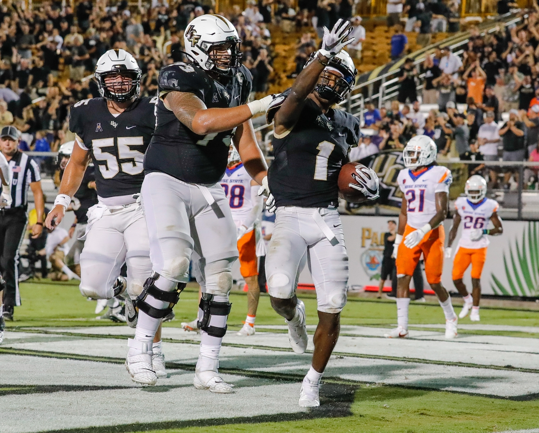 Sep 3, 2021; Orlando, Florida, USA; UCF Knights wide receiver Jaylon Robinson (1) celebrates with offensive lineman Samuel Jackson (73) after scoring a touchdown against the Boise State Broncos during the second half at Bounce House. Mandatory Credit: Mike Watters-USA TODAY Sports