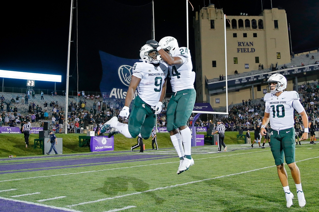 Sep 3, 2021; Evanston, Illinois, USA; Michigan State Spartans running back Kenneth Walker III (9) celebrates his touchdown against the Northwestern Wildcats with running back Elijah Collins (24) during the first quarter at Ryan Field. Mandatory Credit: Jon Durr-USA TODAY Sports