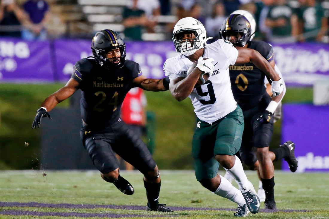 Sep 3, 2021; Evanston, Illinois, USA; Michigan State Spartans running back Kenneth Walker III (9) runs the ball against the Northwestern Wildcats during the second quarter at Ryan Field. Mandatory Credit: Jon Durr-USA TODAY Sports