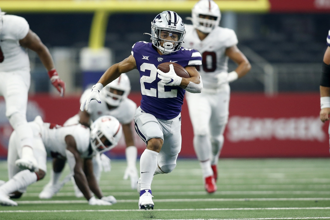 Sep 4, 2021; Arlington, Texas, USA;  Kansas State Wildcats running back Deuce Vaughn (22) runs for a touchdown in the second quarter against the Stanford Cardinal at AT&T Stadium. Mandatory Credit: Tim Heitman-USA TODAY Sports
