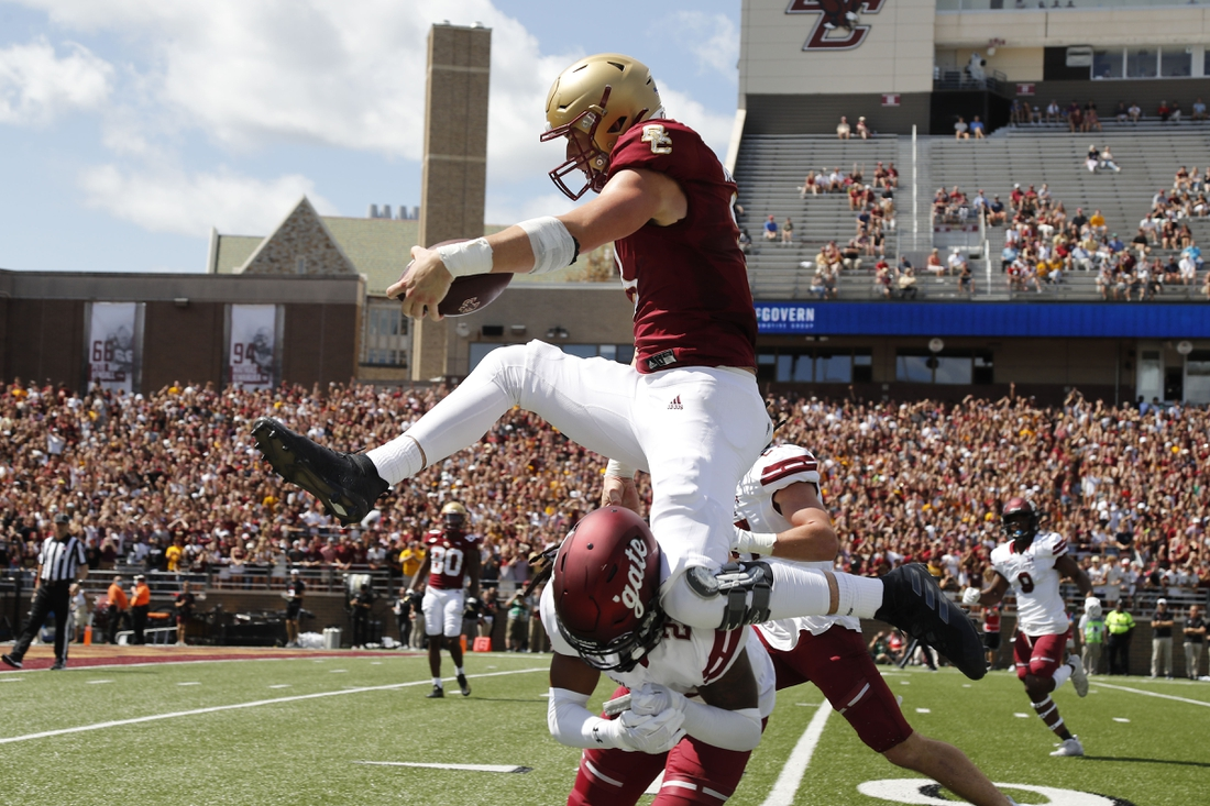 Sep 4, 2021; Chestnut Hill, Massachusetts, USA; Boston College Eagles tight end Trae Barry (3) hurdles Colgate Raiders defensive back Keshaun Dancy (20) for a touchdown during the first half at Alumni Stadium. Mandatory Credit: Winslow Townson-USA TODAY Sports