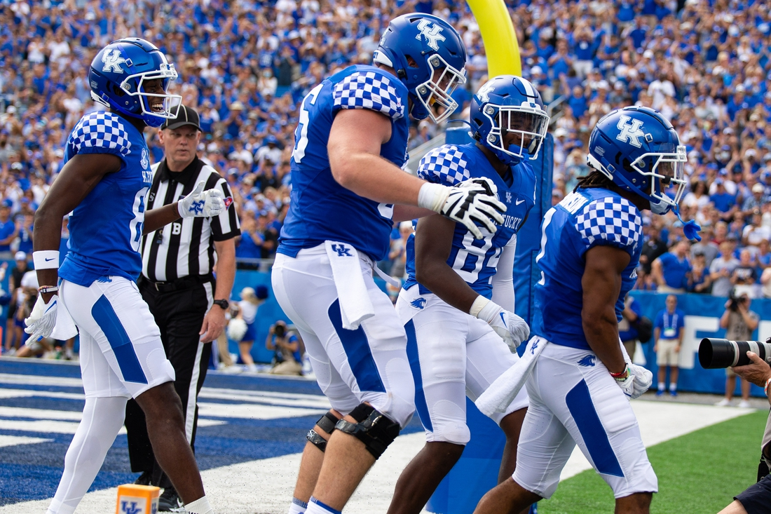 Sep 4, 2021; Lexington, Kentucky, USA; The Kentucky Wildcats offense celebrates a touchdown scored by wide receiver Wan'Dale Robinson (1) during the second quarter against the Louisiana-Monroe Warhawks at Kroger Field. Mandatory Credit: Jordan Prather-USA TODAY Sports