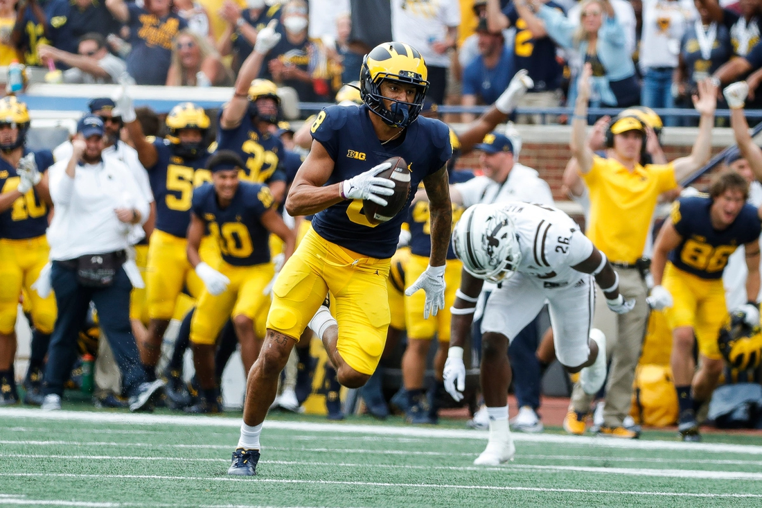 Michigan wide receiver Ronnie Bell runs after making a catch against Western Michigan during the first half in Ann Arbor on Saturday, Sept. 4, 2021.