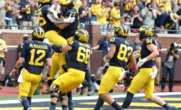 Michigan running back Blake Corum celebrates with teammates after his touchdown against Western Michigan during the first half in Ann Arbor on Saturday, Sept. 4, 2021.Mich West