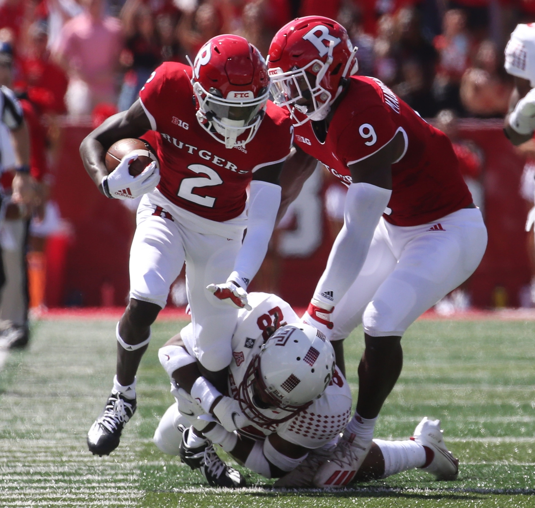 Aron Cruickshank of Rutgers is tackled by M.J. Griffin of Temple in the first half as Temple played Rutgers in the season opener at SHI Stadium in Piscataway, NJ on September 4, 2021.  Temple Played Rutgers In The Season Opener At Shi Stadium In Piscataway Nj On September 4 2021