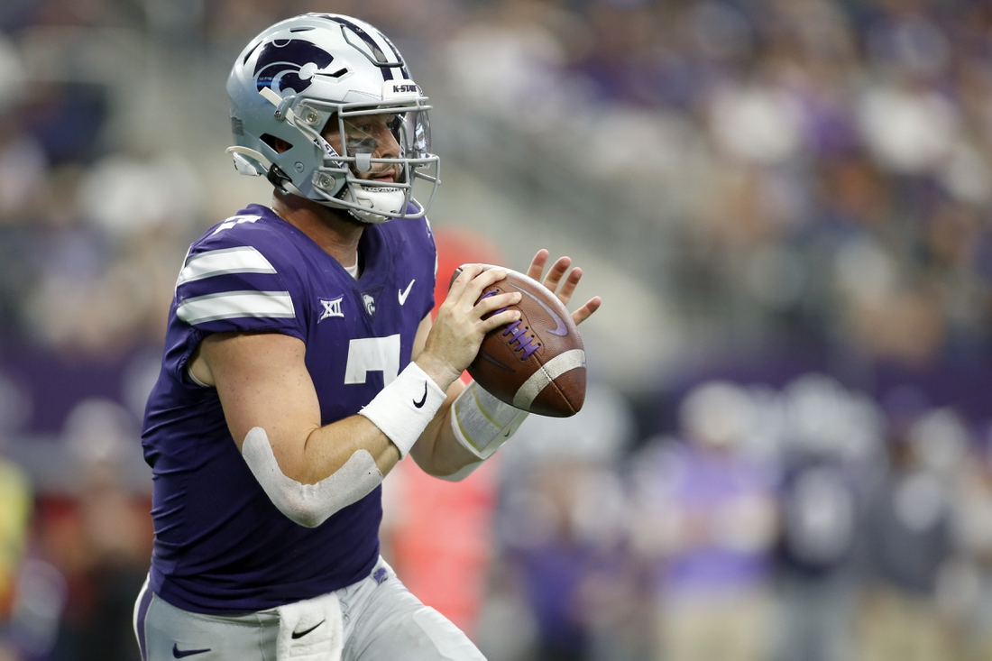 Sep 4, 2021; Arlington, Texas, USA; Kansas State Wildcats quarterback Skylar Thompson (7) rolls out in the third quarter against the Stanford Cardinal at AT&T Stadium. Mandatory Credit: Tim Heitman-USA TODAY Sports