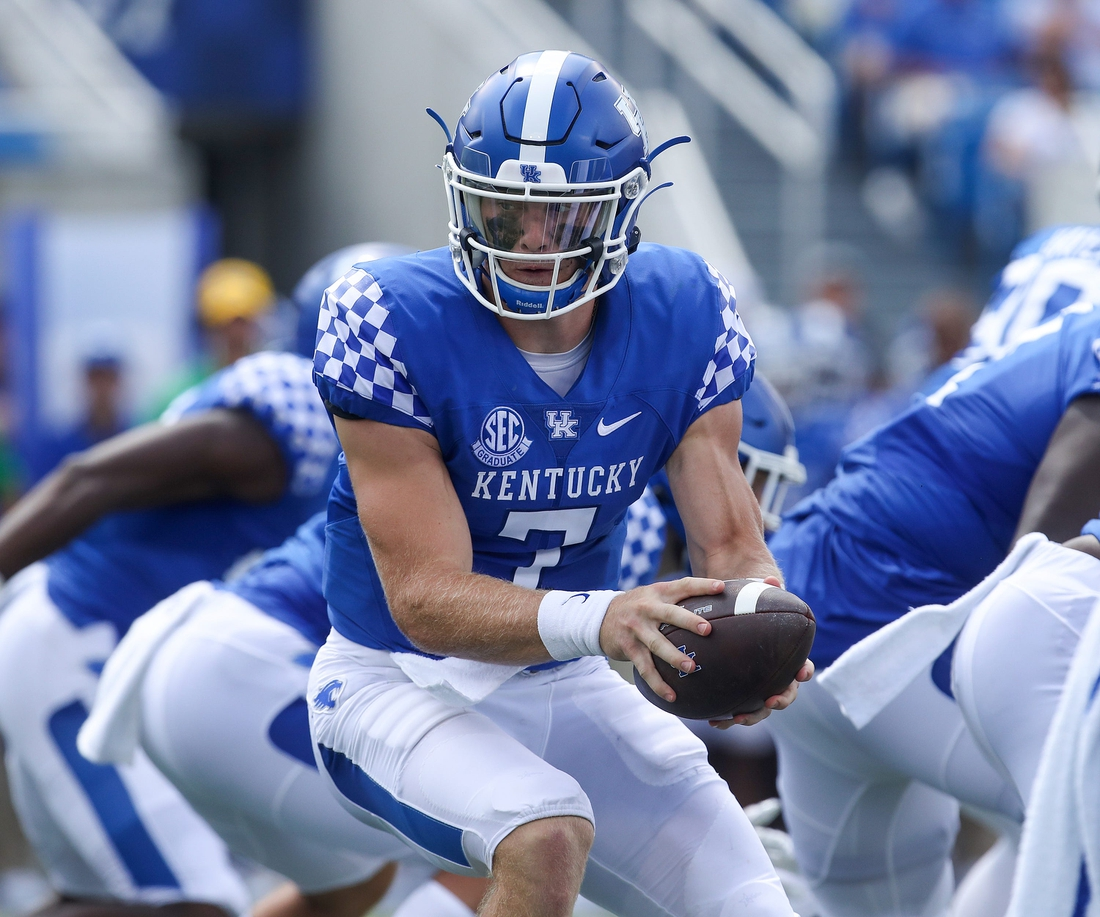 Kentucky quarterback Will Levis hands off in the second half against the ULM Warhawks on Saturday at Kroger Field in Lexington.  Catswarhawks29