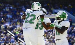 Sep 4, 2021; Annapolis, Maryland, USA; Marshall Thundering Herd running back Rasheen Ali (22) celebrates with  tight end Devin Miller (83) and tight end Xavier Gaines (11) after scoring a first half touchdown against the Navy Midshipmen  at Navy-Marine Corps Memorial Stadium. Mandatory Credit: Tommy Gilligan-USA TODAY Sports