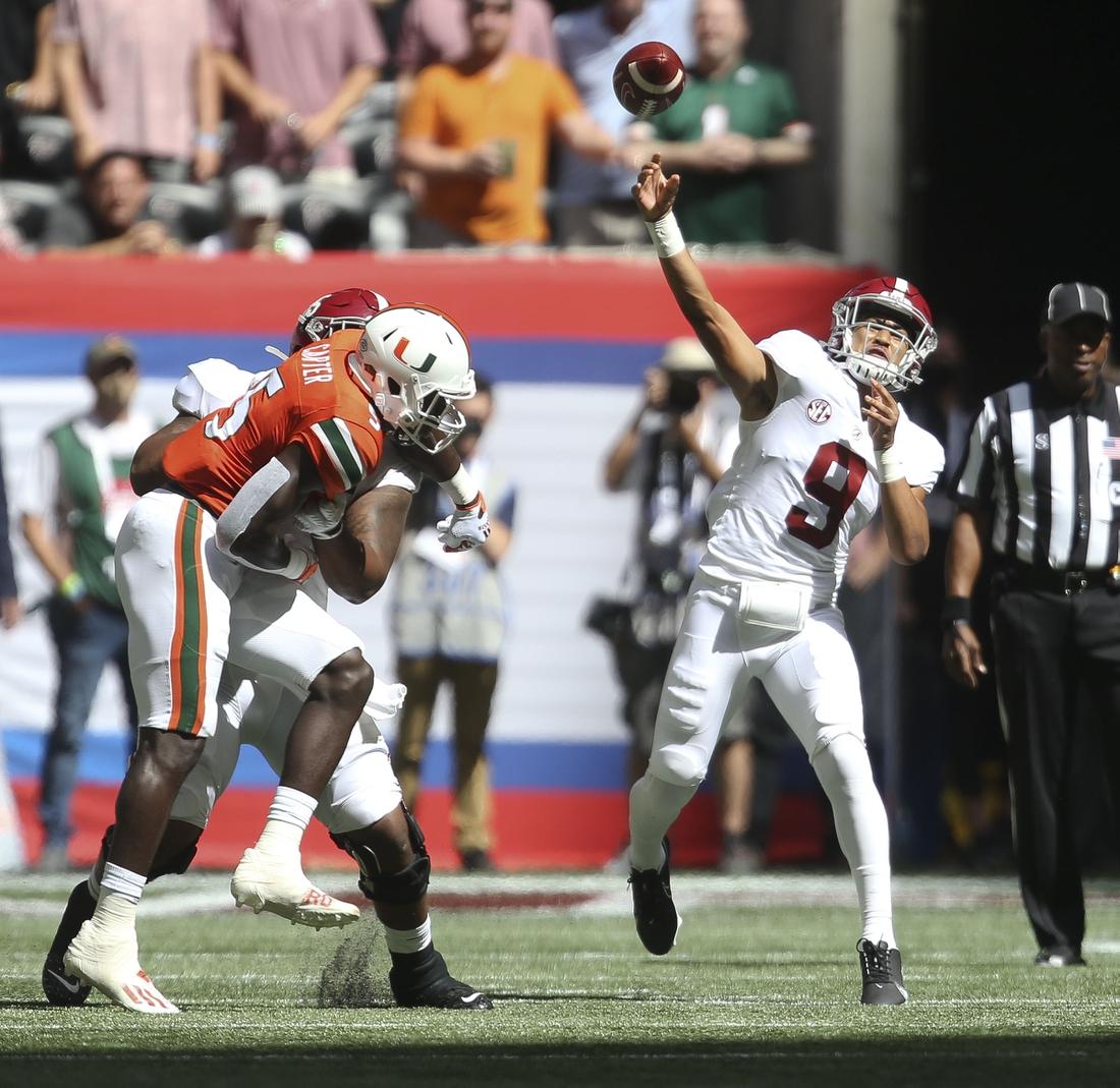 Sep 4, 2021; Atlanta, Georgia, USA;  Alabama quarterback Bryce Young (9) throws against Miami at Mercedes-Benz Stadium. Mandatory Credit: Gary Cosby-USA TODAY Sports