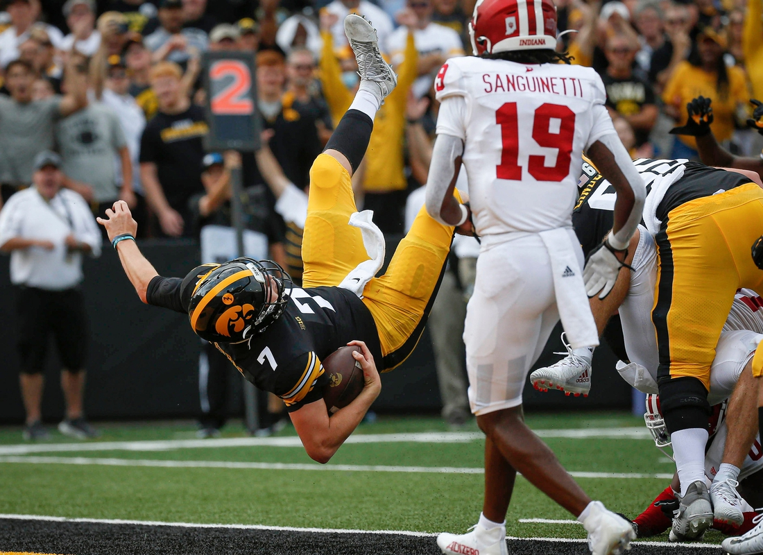 Iowa junior quarterback Spencer Petras dives into the end zone for a Hawkeyes touchdown in the second quarter against Indiana at Kinnick Stadium in Iowa City on Saturday, Sept. 4, 2021.  20210904 Iowavsindiana