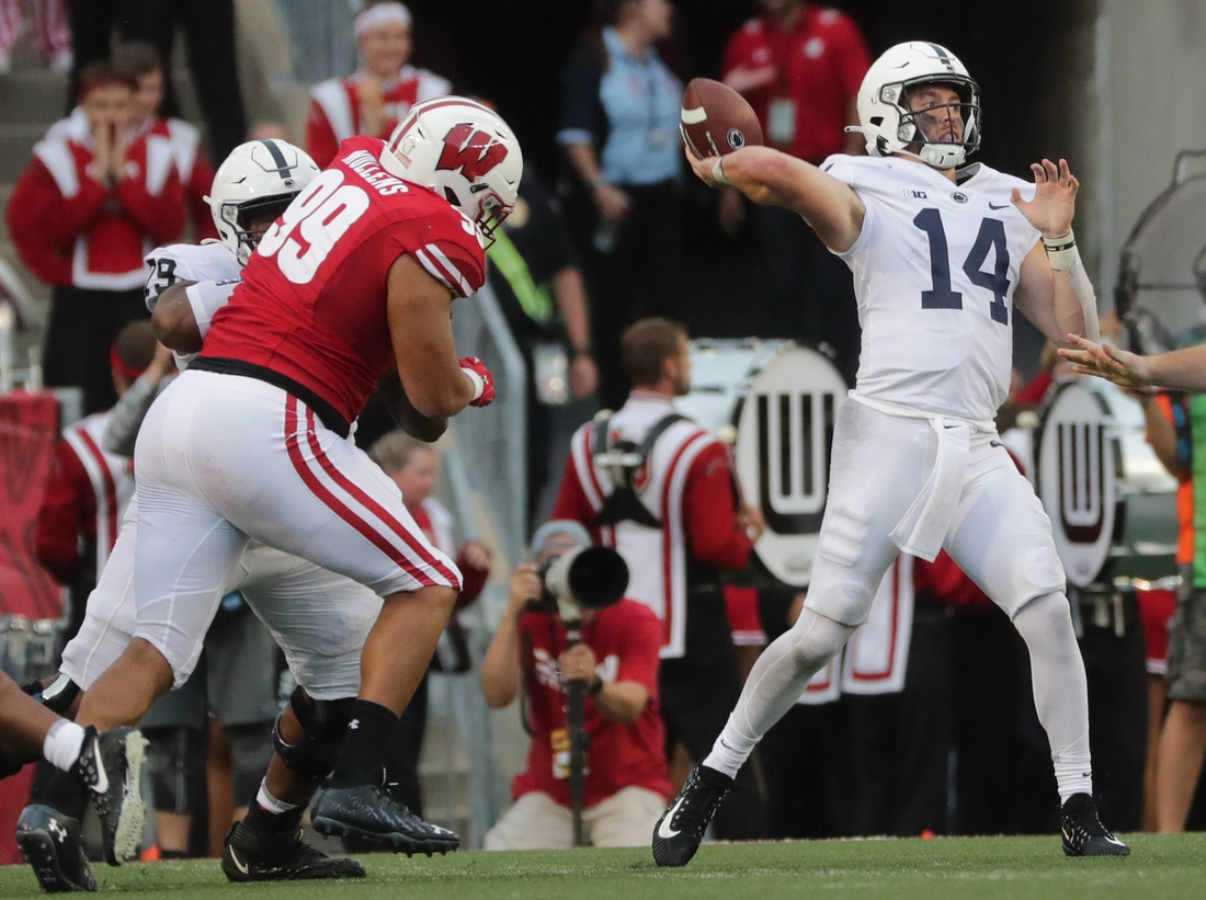 Penn State quarterback Sean Clifford (14) airs out a pass during the third quarter of their game against Wisconsin  Saturday, September 4, 2021 at Camp Randall Stadium in Madison, Wis. Penn State beat Wisconsin 16-10.  Uwgrid05 16