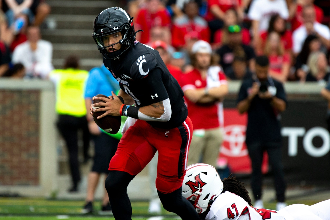 Cincinnati Bearcats quarterback Desmond Ridder (9) is sacked by Miami Redhawks defensive lineman Lonnie Phelps (47) in the second half of the NCAA football game on Saturday, Sept. 4, 2021, at Nippert Stadium in Cincinnati. Cincinnati Bearcats defeated Miami Redhawks 49-14.  Cincinnati Bearcats Miami Redhawks