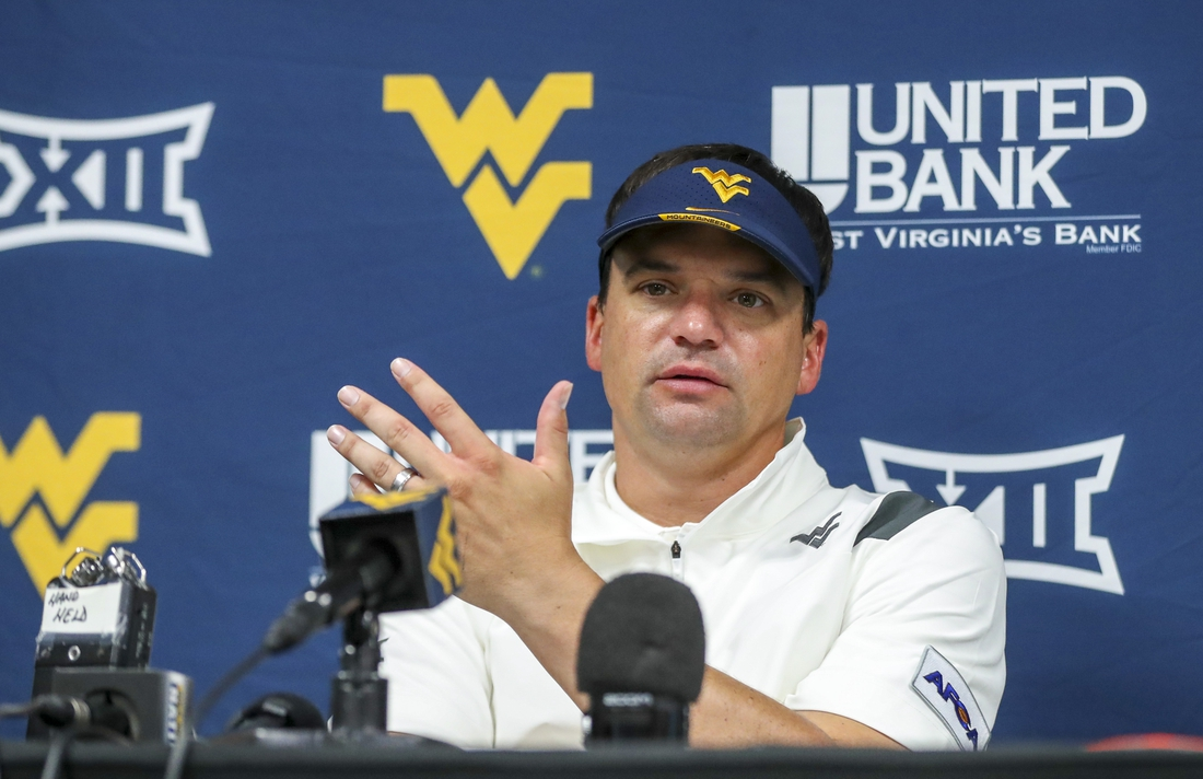 Sep 4, 2021; College Park, Maryland, USA; West Virginia Mountaineers head coach Neal Brown talks to the media after a loss to the Maryland Terrapins at Capital One Field at Maryland Stadium. Mandatory Credit: Ben Queen-USA TODAY Sports