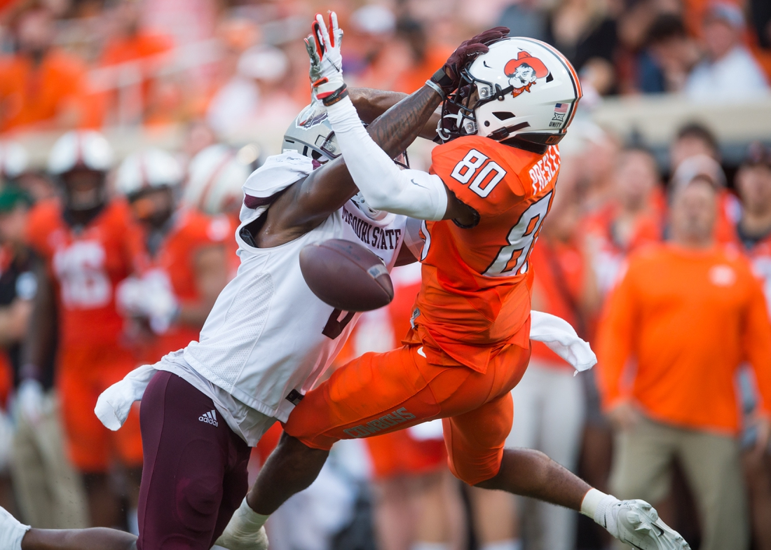 Sep 4, 2021; Stillwater, Oklahoma, USA;  Missouri State Bears safety Kyriq McDonald (6) breaks up a pass intended for Oklahoma State Cowboys wide receiver Brennan Presley (80) during the second quarter at Boone Pickens Stadium. Mandatory Credit: Brett Rojo-USA TODAY Sports