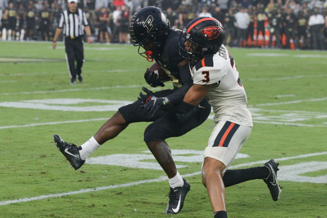 Purdue wide receiver David Bell (3) is tackled by Oregon State defensive back Jaydon Grant (3) during the first quarter of an NCAA college football game, Saturday, Sept. 4, 2021 at Ross-Ade Stadium in West Lafayette.  Cfb Purdue Vs Oregon State