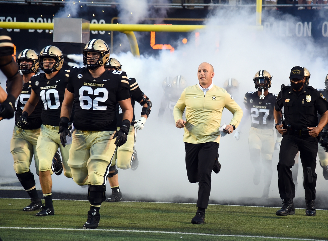 Sep 4, 2021; Nashville, Tennessee, USA; Vanderbilt Commodores head coach Clark Lea takes the field before the game against the East Tennessee State Buccaneers at Vanderbilt Stadium. Mandatory Credit: Christopher Hanewinckel-USA TODAY Sports