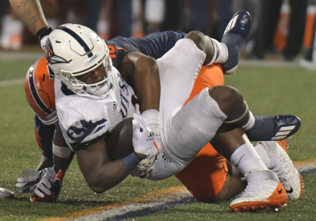 Sep 4, 2021; Champaign, Illinois, USA;  UTSA Roadrunners running back Sincere McCormick (3) is tackled by Illinois Fighting Illini defensive lineman Roderick Perry II (96) in the first half of Saturday   s game at Memorial Stadium. Mandatory Credit: Ron Johnson-USA TODAY Sports