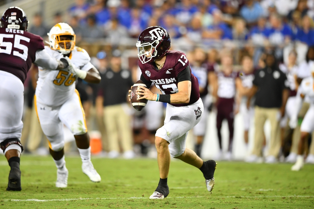 Sep 4, 2021;  College Station, Texas, USA;  Texas A&M Aggies quarterback Haynes King (13) runs the ball during the second quarter against the Kent State Golden Flashes at Kyle Field. Mandatory Credit: Maria Lysaker-USA TODAY Sports