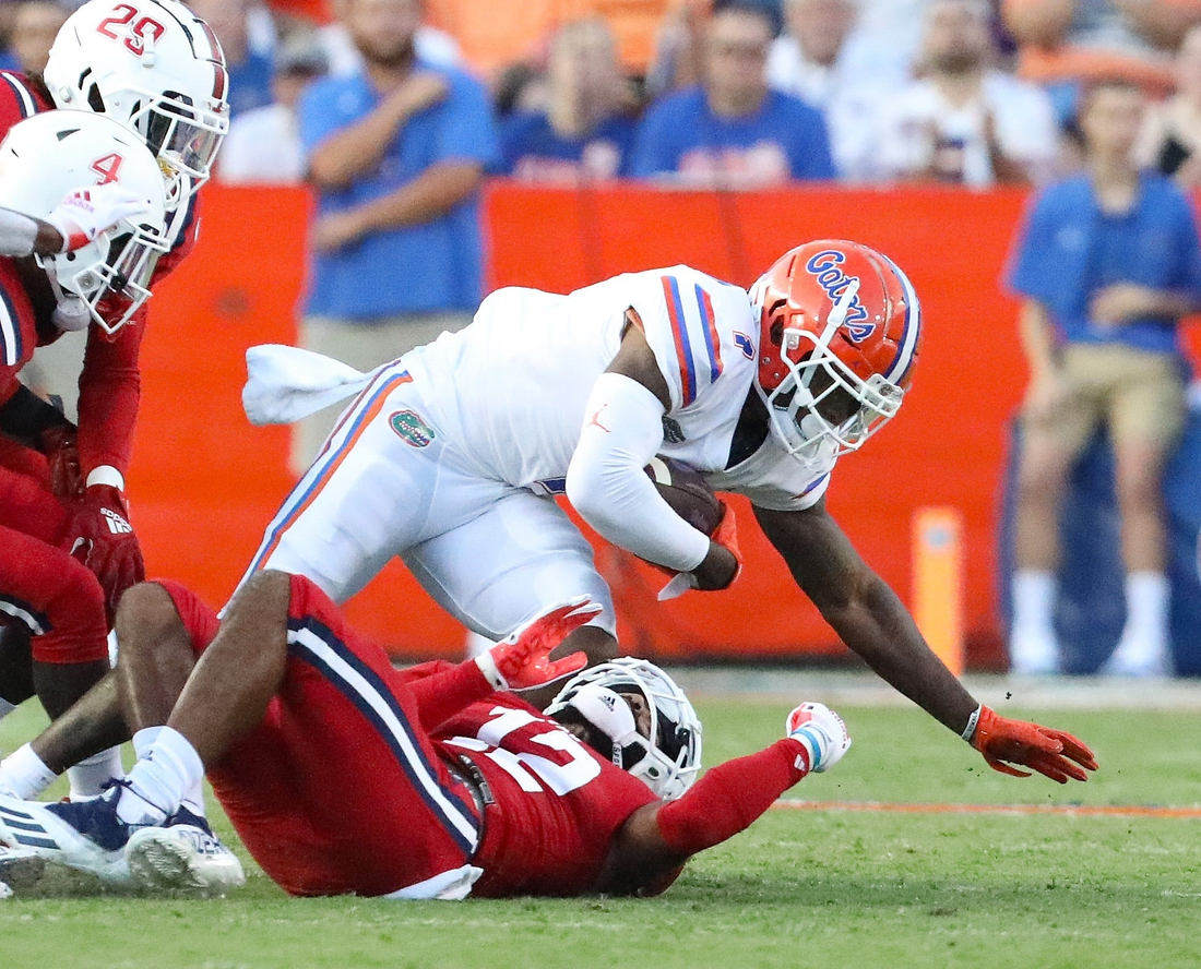 Florida Gators wide receiver Jacob Copeland (1) is brought down after making a catch during a game against the Florida Atlantic Owls at Ben Hill Griffin Stadium in Gainesville Fla. Sept. 4, 2021.  UFfauGameAction22