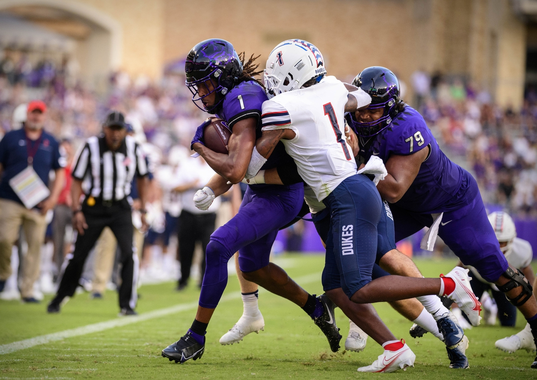 Sep 4, 2021; Fort Worth, Texas, USA; TCU Horned Frogs wide receiver Quentin Johnston (1) is tackled by Duquesne Dukes defensive back Jeremiah Josephs (1) during the first quarter at Amon G. Carter Stadium. Mandatory Credit: Jerome Miron-USA TODAY Sports
