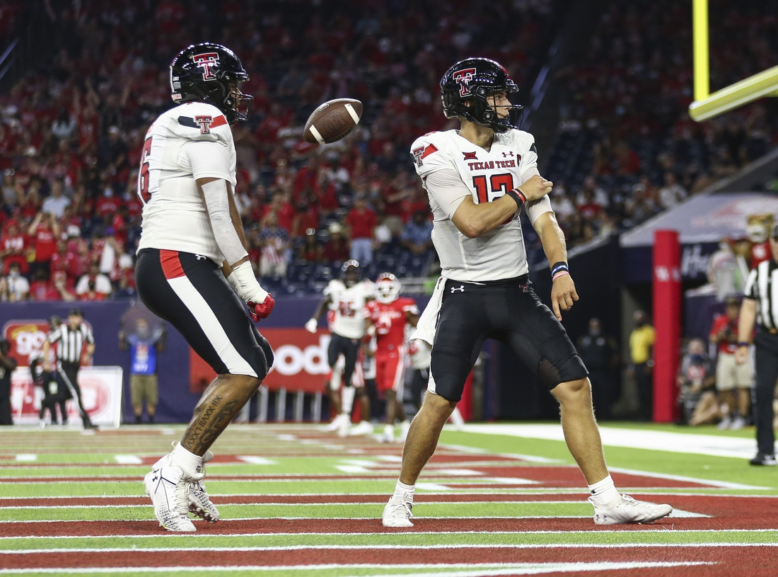 Sep 4, 2021; Houston, Texas, USA; Texas Tech Red Raiders quarterback Tyler Shough (12) reacts after rushing for a touchdown during the third quarter against the Houston Cougars at NRG Stadium. Mandatory Credit: Troy Taormina-USA TODAY Sports