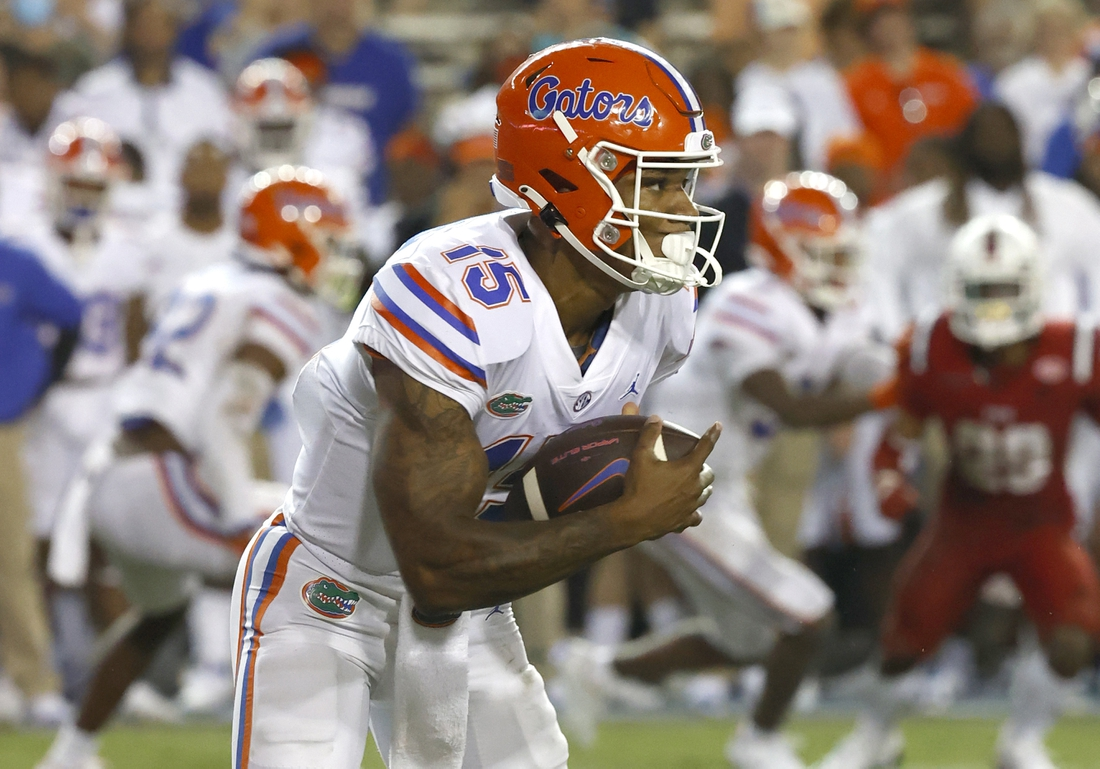 Sep 4, 2021; Gainesville, Florida, USA; Florida Gators quarterback Anthony Richardson (15) runs the ball in for a touchdown during the fourth quarter against the Florida Atlantic Owls at Ben Hill Griffin Stadium. Mandatory Credit: Kim Klement-USA TODAY Sports