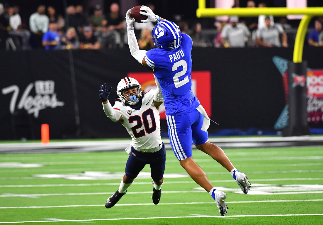 Sep 4, 2021; Paradise, Nevada, USA;  Brigham Young Cougars wide receiver Neil Pau'u (2) makes a catch as Arizona Wildcats cornerback Treydan Stukes (20) defends on the play during a game at Allegiant Stadium. Mandatory Credit: Stephen R. Sylvanie-USA TODAY Sports