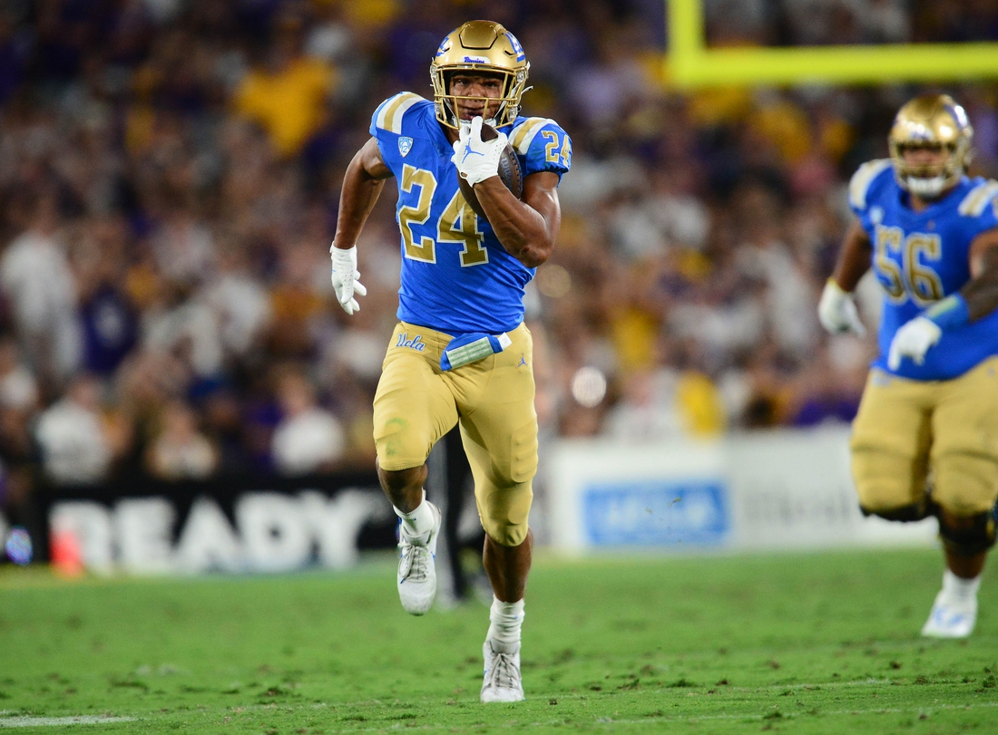 Sep 4, 2021; Pasadena, California, USA; UCLA Bruins running back Zach Charbonnet (24) runs the ball against the Louisiana State Tigers during the second half the at the Rose Bowl. Mandatory Credit: Gary A. Vasquez-USA TODAY Sports