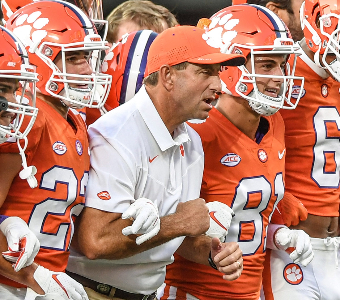 Clemson head coach Dabo Swinney is between his sons wide receiver Will Swinney(22), left, and wide receiver Drew Swinney(81) and the team for the Walk of Champions before Clemson and Georgia played in the Duke's Mayo Classic Sep 4, 2021; Charlotte, North Carolina, USA;  at Bank of America Stadium.  Ncaa Football Georgia At Clemson