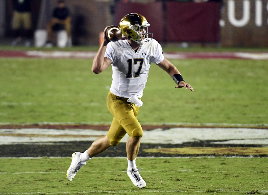 Sep 5, 2021; Tallahassee, Florida, USA; Notre Dame Fighting Irish quarterback Jack Coan (17) runs with the ball during the second quarter against the Florida State Seminoles at Doak S. Campbell Stadium. Mandatory Credit: Melina Myers-USA TODAY Sports