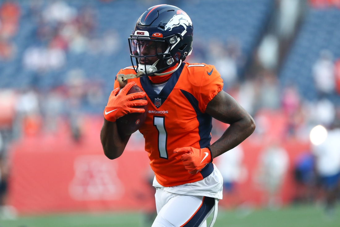 Aug 28, 2021; Denver, Colorado, USA; Denver Broncos wide receiver K.J. Hamler (1) warms up before the game against the Los Angeles Rams at Empower Field at Mile High. Mandatory Credit: C. Morgan Engel-USA TODAY Sports