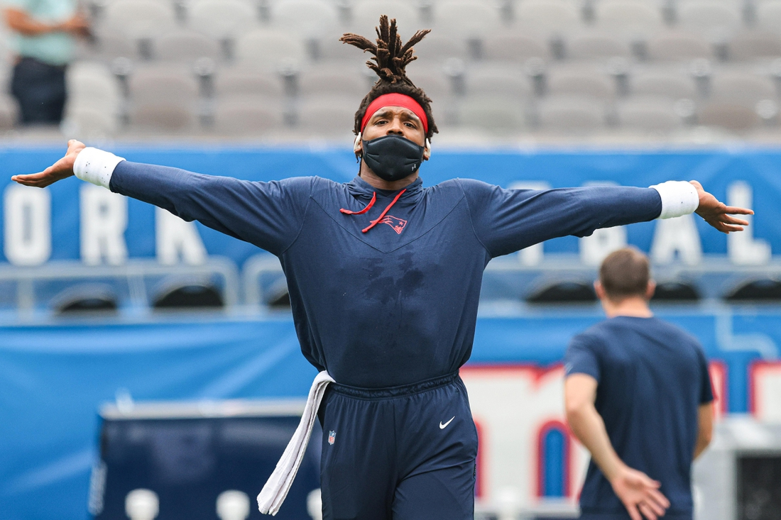 Aug 29, 2021; East Rutherford, New Jersey, USA; New England Patriots quarterback Cam Newton (1) warms up against the New York Giants before the game at MetLife Stadium. Mandatory Credit: Vincent Carchietta-USA TODAY Sports