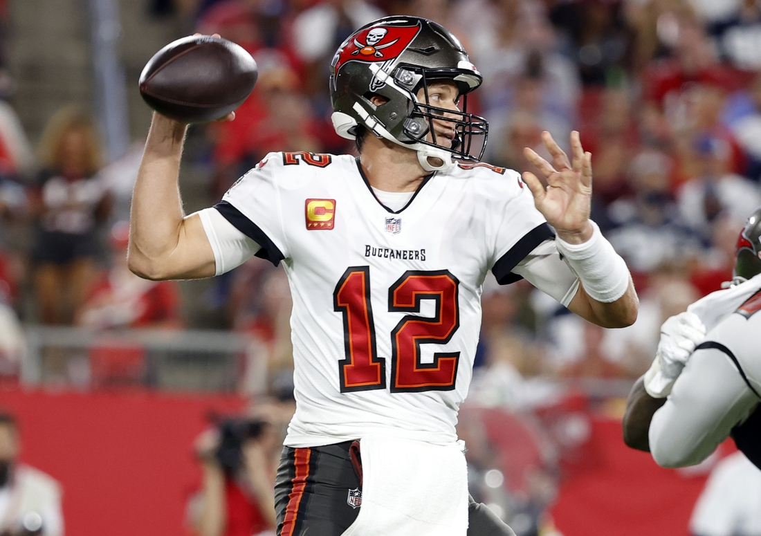 Sep 9, 2021; Tampa, Florida, USA; Tampa Bay Buccaneers quarterback Tom Brady (12) throws the ball against the Dallas Cowboys during the first half at Raymond James Stadium. Mandatory Credit: Kim Klement-USA TODAY Sports