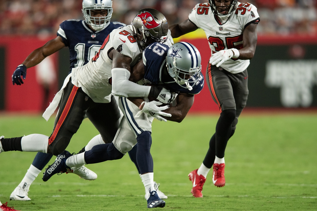 Sep 9, 2021; Tampa, Florida, USA; Tampa Bay Buccaneers line backer Shaquil Barrett (58) tackles Dallas Cowboys wide receiver Michael Gallup (13) in the second quarter at Raymond James Stadium. Mandatory Credit: Jeremy Reper-USA TODAY Sports