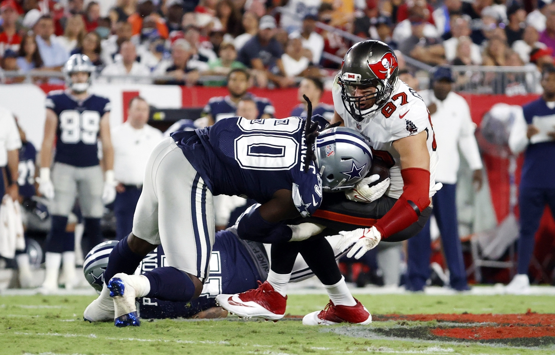 Sep 9, 2021; Tampa, Florida, USA; Tampa Bay Buccaneers tight end Rob Gronkowski (87) catches the ball against Dallas Cowboys defensive end DeMarcus Lawrence (90) during the first half at Raymond James Stadium. Mandatory Credit: Kim Klement-USA TODAY Sports