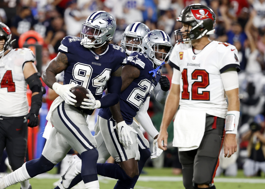 Sep 9, 2021; Tampa, Florida, USA; Dallas Cowboys defensive end Randy Gregory (94) reacts after recovering the ball against the Tampa Bay Buccaneers during the first half at Raymond James Stadium. Mandatory Credit: Kim Klement-USA TODAY Sports