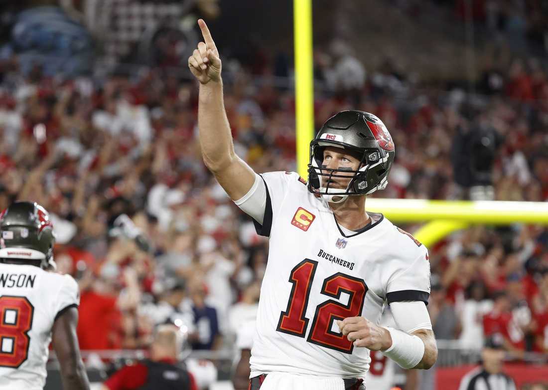 Sep 9, 2021; Tampa, Florida, USA; Tampa Bay Buccaneers quarterback Tom Brady (12) celebrates after a Buccaneers touchdown  against the Dallas Cowboys during the first half at Raymond James Stadium. Mandatory Credit: Kim Klement-USA TODAY Sports
